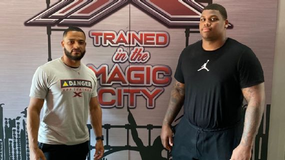 Jets Quinnen Williams with personal trainer Kevin Brown