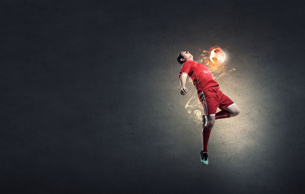 Jpg. Football player in red shirt jump taking ball