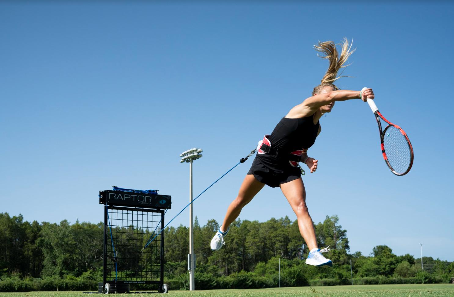 Tennis girl serving training on VertiMax Raptor